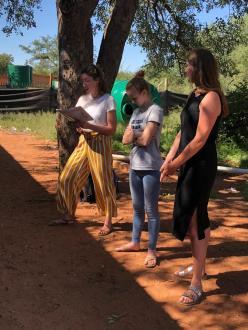 Volunteers help reading Katy's Hyena Time