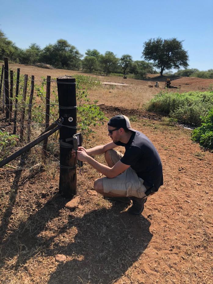 Jamie servicing Chloe's cameras round livestock kraals